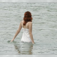 Woman Wading into Water