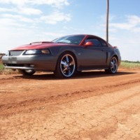 Maroon Mustang GT on 20s