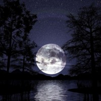 Blue Moon Rising Over Water
