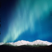 Northern Lights Over Snowy Mountains